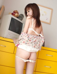 Adorable Japanese teenage Anna Suzukaze demonstrates her cunt via see thru panties