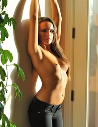 Teen solo girl with long hair exposes her stiff breasts in jeans