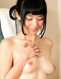 Dark haired Asian masseuse Marica Hase deepthroats the nuts sac during a nuru rubdown