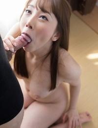 Japanese girl Kisaki Aya licks her lips of pleasure gel while sucking cock on knees