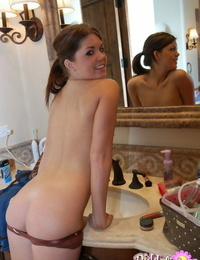 Cute youthful girl Diddylicious blows a smooch while baring her taut ass
