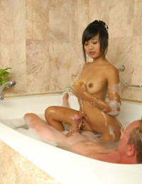 Hot youthfull Asian teenager lathers white cock for massage & rails on top in bathtub tub