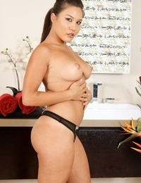 Asian masseur Mena Li reveals her fat tits and enormous ass while getting nude