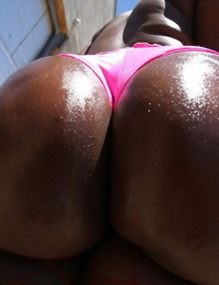 Black Mummy Aryana Starr exposes her immense greased Jamaican booty in the sun