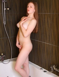 Playful ginger Nerila washes her big juggs and hungry vagina in the tub