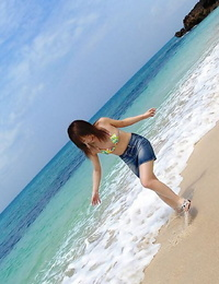 Japanese teenager Chikaho Ito models non naked at the beach in a bikini