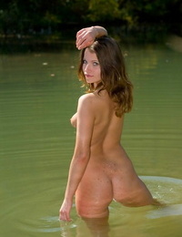 Scorching young Angilie splashes stark naked in the sea showcasing her wet booty