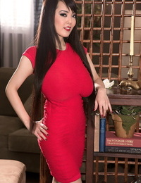 Stunning Asian woman Hitomi with massive thick knockers in tight dress takes off naked