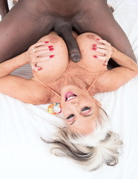 Hot granny Sally DAngelo tit fucks a big black cock with her knockers