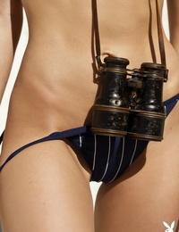 Redhead model Valeria Lakhina terrific binoculars while posing nude for Playboy