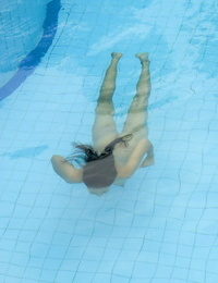 Young Asian lady with hard tits and a utter pubic hair swims bare in a pool