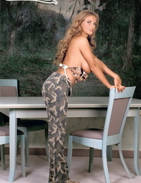 Hot Mummy Ines Cudna uncups her gorgeous hooters as she undresses nude on a patio