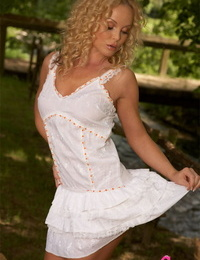 Curly haired blond Silvia Saint labyrinth her ass in whit underwear and undies