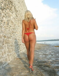 Hot Mummy Ines Cudna relases her big boobs from bathing suit along a seawall