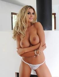Molten blond lady Tommie Jo gets nude on a hardwood floor