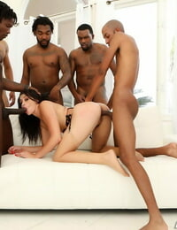 Dark haired hoe wears spunk on her face after an multiracial gangbang