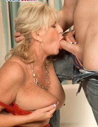 Horny granny Anneke Nordstrum gets her thick boobs deepthroated my a younger man