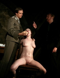 Naked prisoner Sophie has a faux-cock pushed down her throat by her guards