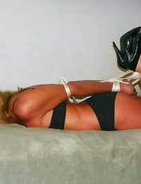 Light-haired girl is trussed up with rope and left gagged in undergarments and pumps