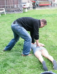 Young lady Veronika caught- hogtied- gagged- and left lounging on the grass