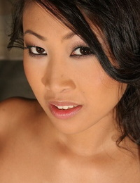 Smoking hot Asian honey Sharon Lee strips and unveils her thick hooters
