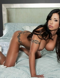 Buxomy centerfold model Pleasure buttons Jade switches her lingerie during a solo shoot