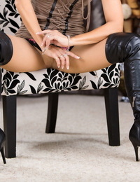 Hot mature woman Roni Ford models in lengthy shoes and hose with a bustier