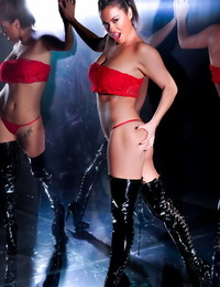Solo model Kandi Kay heads stripped to the waist in a panty and stripper shoes