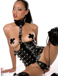 Solo model Chems shows her boobs and twat in fetish wear and OTK footwear