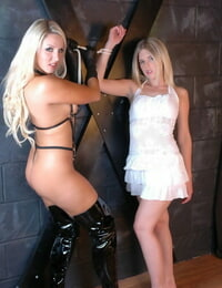 Scorching blonde Dannii Harwood trusses up a younger blonde girl in sfw act
