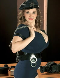 Fat boobed chick Christy Marks removes her uniform on her policewomans desk