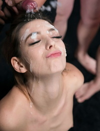 Allegiance naked chick closes her eyes during a bukkake session