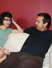 Geeky teenager Bailey gets nude while providing a hand job with her glasses on