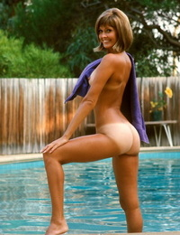 Exotic centerfold Sharon Clark showing off her suntanned tits and booty