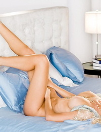 Seductive Tiffany Toth flaunting her knockers while posing on the couch
