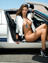 Naturally buxomy brunette angel Alyssa Arce suns her big tits at the race track
