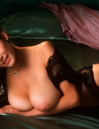 Gorgeous brunette models posing in corsets and demonstrating their killer fat boobs