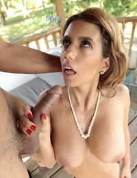 Euro MILF Mia Ryder blows thick cock outside and gets cum on face