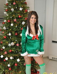 Amateur Xmas elf Hailey hoists her taut mini-skirt to display her wonderful nut sack by the tree
