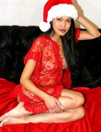 Petite Asian chick displays her bald beaver in Xmas themed undergarments and cap