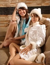 2 naughty lil\' snow bunnies smooching and spandex each other before the fire