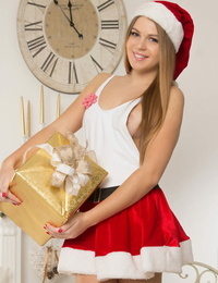 Tongues teenager Eveline shows her taut beaver in Christmas handling