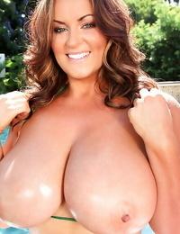 Outdoor posing at the pool features huge boobs pornstar Sarah Nicola Randall