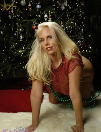 Scorching light-haired Karen Fisher shows off her large knockers in front of Xmas tree
