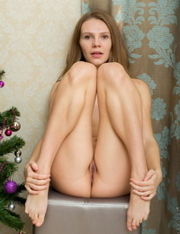 Solo model Elina De Leon without bra her nude pussy by the Christmas tree
