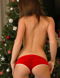 Teenage amateur Kate poses for naughty SFW poses in front of the Christmas tree