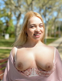 Big blond plays with her pussy after getting off tits and undergarments in public