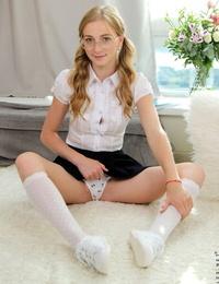 Nerdy schoolgirl Elizabeth Evans undresses cute panties before pussy finger-tickling