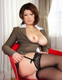 Japanese MILF exposes huge natural hooters in nylons and garters