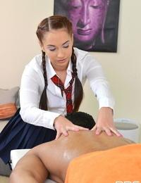 Horny teenage masseur Jenny masturbates off lubed brown shaft on massage table